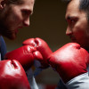 Two furious businessmen in boxing gloves attacking one another
