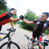 two friends have fun outdoor in nature and ride  on muntain bike